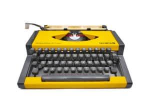 Machine à écrire Olympia Dactymetal De Luxe jaune révisée ruban neuf