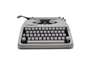 Machine à écrire Hermes baby blanche qwertz suisse révisée ruban neuf