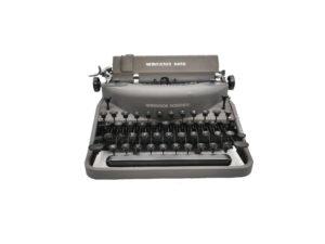Machine à écrire Remington Noiseless grise révisée ruban neuf