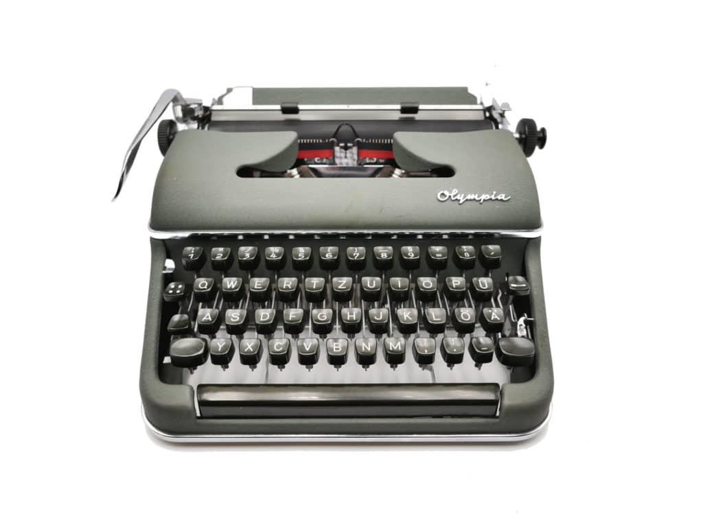 Machine à écrire Olympia SM3 verte ruban neuf révisée 1964