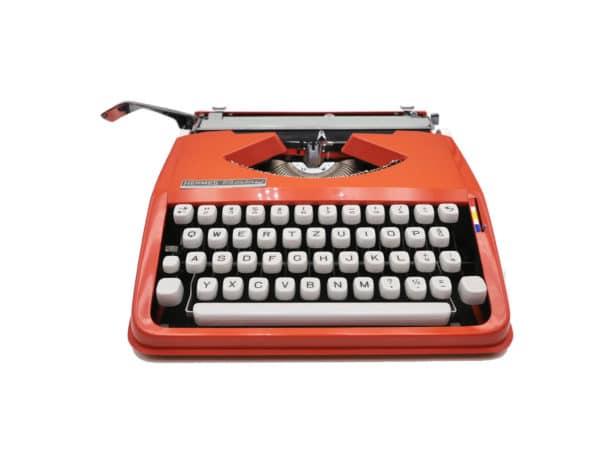Machine à écrire Hermes Baby rouge corail révisée ruban neuf