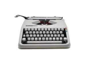 Machine à écrire Hermes Baby blanche Cursive révisée ruban neuf